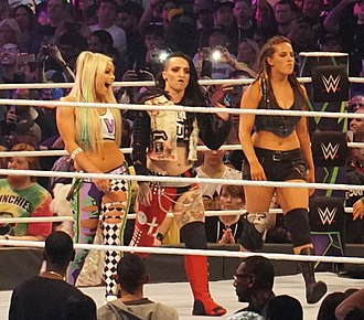 Liv Morgan - Morgan (left) along with her fellow members of The Riott Squad Ruby Riott (center) and Sarah Logan (right) at WrestleMania 34