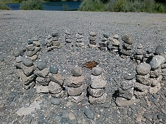 """American River Parkway - Rock art formation by the """"Mysterious rock artist"""" located at the Watt Avenue access point in Sacramento, California."""