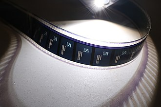 Film gauge - A 35 mm film gauge illuminated with the flashlight of a smartphone.