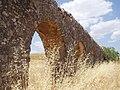 Roman aqueduct in grain field.jpg