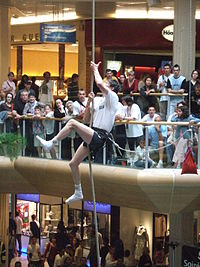 A competitor in a rope climbing event, at Lyon's Part-Dieu shopping centre.