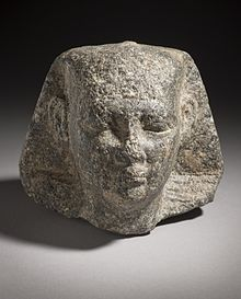 Head of a pharaoh, wearing the nemes.