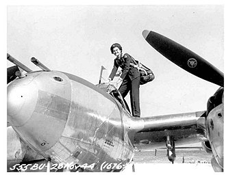 Lockheed P-38 Lightning - WASP Ruth Dailey climbs into a P-38.