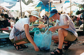 Service Civil International - Cleaning a market in Cambodia