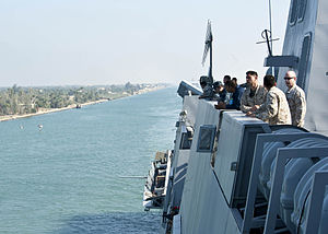 Sailors and Marines look on as the amphibious transport dock ship USS New York (LPD 21) transits the Suez Canal..jpg