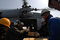 Sailors and aid workers load supplies for relief efforts in Japan following earthquake..jpg