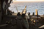 Sailors clean and maintain an F-A-18F Super Hornet in the hangar bay of USS Dwight D. Eisenhower. (33490052700).jpg
