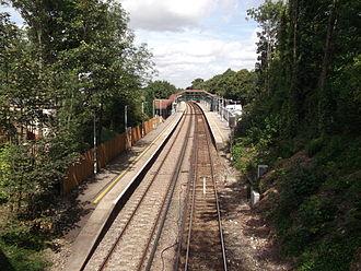Sanderstead railway station - Sanderstead station looking north from the bridge carrying Sanderstead Road over the line.