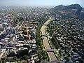Santiago de Chile from Gran torre Santiago, Mapocho river.JPG