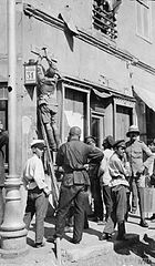 Sappers hanging sign boards at Baku directing troops to the different sectors of the front.jpg
