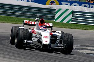 Takuma Sato - Sato celebrates his only Formula One podium finish, at the 2004 United States Grand Prix.
