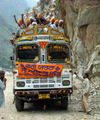 Sikh pilgrims cheering on bus to Manikaran.jpg