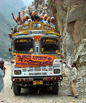 Kullu district - Image: Sikh pilgrims cheering on bus to Manikaran