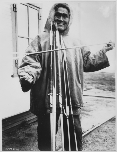 File:Simiguluk, an Eskimo spear and lancemaker with his wares, Point Barrow, Alaska, 1935 - NARA - 531121.tif