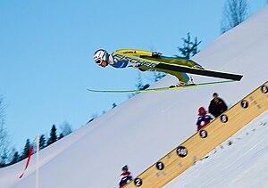 Ski flying - Simon Ammann flying down the hill in Vikersund, 2011