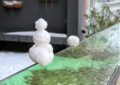 Small snowman on the glass parapet.png