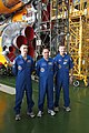 Soyuz TMA-22 crew in front of their booster rocket.jpg