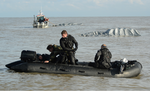 Special Ops Airmen in Zodiac Boat.png