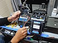 Splicing fiber optic cables in a communications cabinet in a power facility in Queens. 10-02-2019 (48844065221).jpg