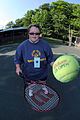 Stacey Brinson hits the ball with her racket as she prepares to take part in the tennis competition during the Special Olympics at Coonskin Park in Charleston, W.Va., June 4, 2011 110604-F-NH898-009.jpg
