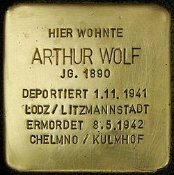 Photo of Arthur Wolf brass plaque