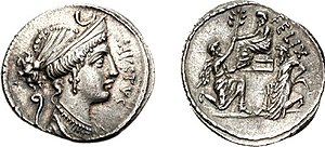 Jugurtha - Denarius coin, Reverse: Sulla seated left on a raised seat; before him kneels Bocchus, offering an olive-branch; behind, Jugurtha kneeling left, 56 BC.