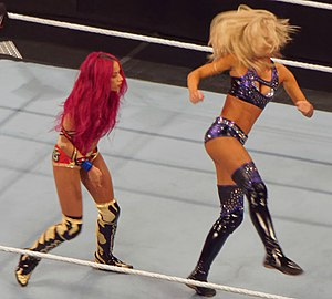 Summer Rae - Rae setting up to perform a spinning heel kick on Sasha Banks
