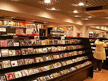 An aisle in a store showing rows of CDs for sale.