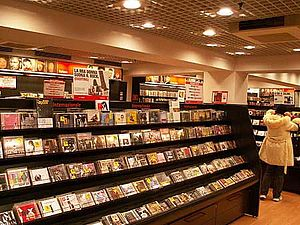 Music of Italy - Inside a Feltrinelli superstore showing rows of CDs.