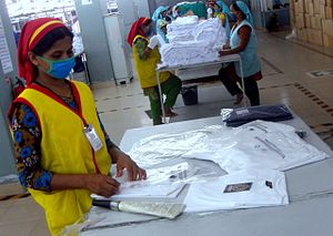 Textile industry in Bangladesh - T-shirt quality checking in a ready made garment factory of Bangladesh