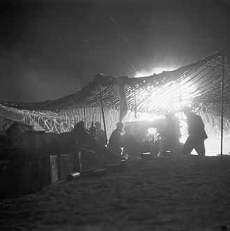 Battle of the Mareth Line - A British 25-pounder field gun in action at night, during the assault on the Mareth Line