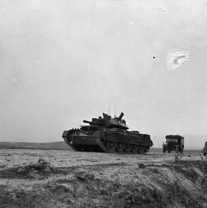 6th Armoured Division (United Kingdom) - Crusader III tank of the 17th/21st Lancers on a road near Bou Arada, Tunisia, 13 January 1943.
