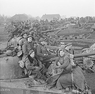 2nd Canadian Division during World War II - Sherman tanks of the 10th Armoured Regiment (The Fort Garry Horse) with infantry of the Royal Regiment of Canada massing in preparation for the assault on Goch, 17 February 1945