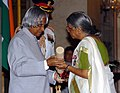 The President, Dr. A.P.J. Abdul Kalam presenting Padma Shri to Smt. Sugatha Kumari, a well known poet and social activist, at an Investiture Ceremony at Rashtrapati Bhavan in New Delhi on March 29, 2006.jpg