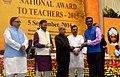 The President, Shri Pranab Mukherjee presenting the National Award for Teachers-2015 to Shri Sambhaji Govind Patil (Maharashtra), on the occasion of the 'Teachers Day', in New Delhi.jpg