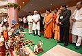 The Prime Minister, Shri Narendra Modi meets the artisans and weavers, at the Deendayal Hastkala Sankul, in Varanasi, Uttar Pradesh.jpg