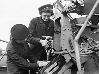 Women's Royal Naval Service - Two Ordnance Wrens in Liverpool reassemble a section of a pom-pom gun during the Second World War.