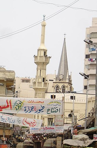 Religion in Egypt - A common religious scene in Egypt: a mosque next to a church.