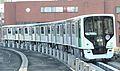 Toei Nippori-Toneri Liner 330 series Nishi-Nippori station.JPG