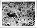 Tommy washing in a shell hole (4688558704).jpg