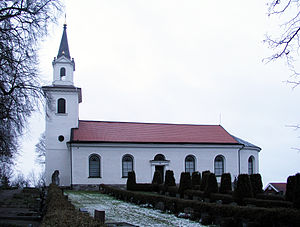 Östergötland Runic Inscription MÖLM1960;230 - The church at Tornevalla showing the runestone in front of the church tower.