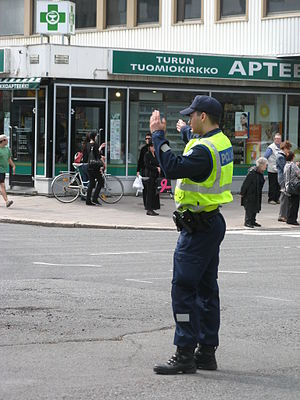Crime in Finland - A Finnish policeman directing traffic in Turku.
