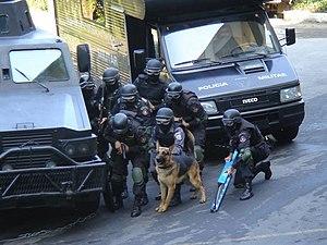 Batalhão de Operações Policiais Especiais - BOPE officers during a training exercise.