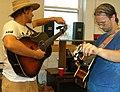 Trent Wagler and Chris Howdyshell tuning guitars Lawn Jam Our Community Place Harrisonburg VA June 2008.jpg
