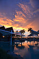 Tropical Sunset over the pool (6762549211).jpg
