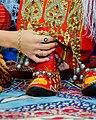 Turkmen bride's shoes wearing ceremony.jpg