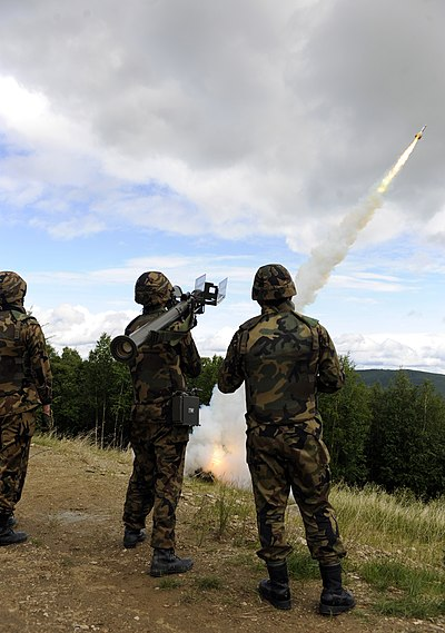 A three-person JASDF fireteam fires a missile from a Type 91 Kai MANPAD during an exercise at Eielson Air Force Base, Alaska as part of Red Flag - Alaska. Type 91 SAM fire.JPG