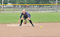 U.S. Coast Guard Petty Officer 3rd Class Christopher Yaw, a public affairs specialist with the 9th Coast Guard District External Affairs Office in Cleveland, fields a ground ball during his unit's softball 130731-G-KB946-006.jpg