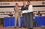 U.S. Consul General Lahore Zachary Harkenrider and GM Grid System Construction Wajahat Saeed Rana distributing certificate to one of the 71 trainees. (22358098634).jpg
