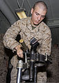 U.S. Marine Corps Lance Cpl. Lucas Savoie, assigned to Battalion Landing Team, 3rd Battalion, 2nd Marine Regiment, 26th Marine Expeditionary Unit (MEU), performs maintenance on the tripod of an M252 81 mm mortar 130318-M-BS001-002.jpg